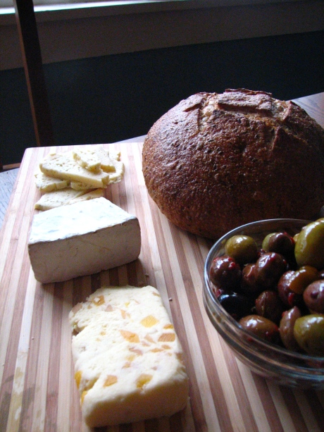 Stilton with Mango and Ginger, Brie, Havarti with Herb. Spicy Olives. 5 Grain Boule from Praire Thunder Bread Co.